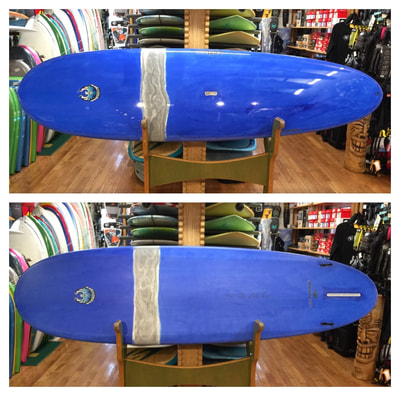 "COREVAC, CANNIBAL, SUP , PADDLEBOARD,LB 9'6"" x 30.25"" x 4.25"" 134L   COREVAC CANNIBAL SUP LB is a stretched out version of a high performance longboard. Will handle 1-6+ foot surf. From nose-riding, to pivot turns, and glide that will connect through flat sections of waves allowing for long rides. 2 + 1 fin set up allows for a variety of arrangements from single fin, to small side-bites, to a thruster set-up."